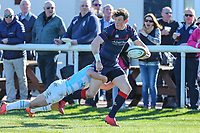 Jordan Burns of Bedford Blues attempts to tackle Peter Lydon of London Scottish during the Greene King IPA Championship match between London Scottish Football Club and Bedford Blues at Richmond Athletic Ground, Richmond, United Kingdom on 25 March 2017. Photo by David Horn / PRiME Media Images.