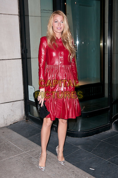 Blake Lively.Christian Louboutin - Book Launch, New York City, NY, USA..November 2nd, 2011.full length red leather dress snakeskin shoes drop waist buttons black clutch bag.CAP/ADM/CS.©Christopher Smith/AdMedia/Capital Pictures.