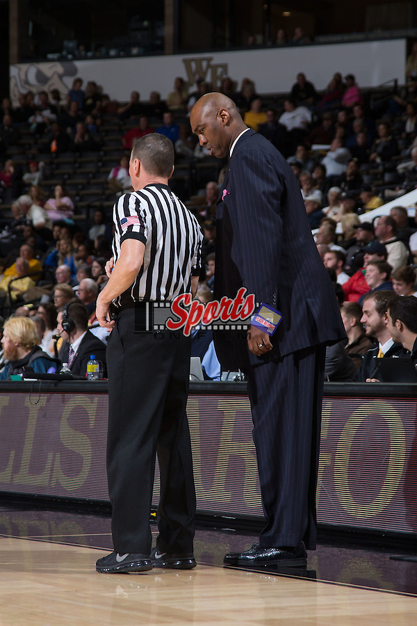 Wake Forest Demon Deacons head coach Danny Manning listens to official Bill McCarthy explain a call during second half action against the UNCG Spartans at the LJVM Coliseum on December 15, 2015 in Winston-Salem, North Carolina.  The Demon Deacons defeated the Spartans 81-71.  (Brian Westerholt/Sports On Film)
