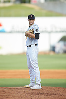 Birmingham Barons relief pitcher Codi Heuer (12) looks to his catcher for the sign against the Pensacola Blue Wahoos at Regions Field on July 7, 2019 in Birmingham, Alabama. The Barons defeated the Blue Wahoos 6-5 in 10 innings. (Brian Westerholt/Four Seam Images)