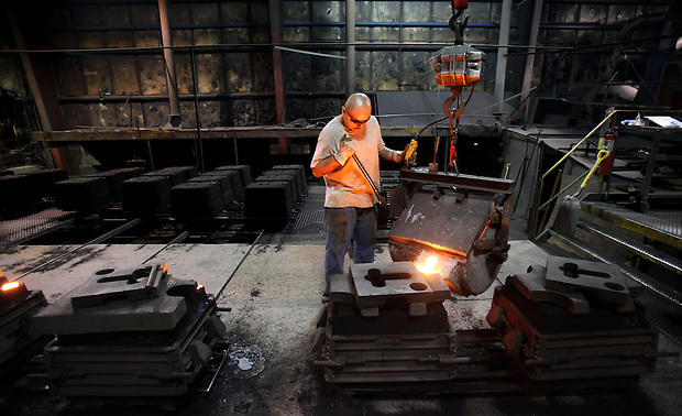Martin Zacarias pours molten iron into a form at Seneca Foundry in Webster City, Iowa.  The company employs about 40 people.  The foundry's president, Kirk McCollugh, says Webster City should play to manufacturing strengths in trying to attract new jobs, but also look to attracting a mix of businesses for long-term health.