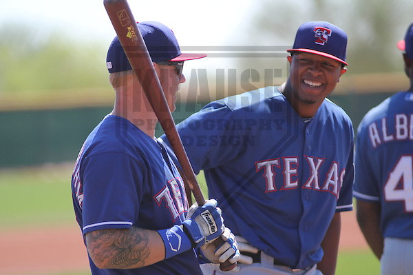 SURPRISE - March 2013: Jeremy Williams (99) and Aaron Cunningham (19)  of the Texas Rangers during a Spring Training workout on March 25, 2013 at Surprise Recreation Center in Surprise, Arizona.  (Photo by Brad Krause).