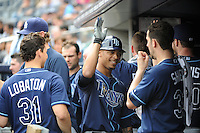 Tampa Bay Rays outfielder Desmond Jennings #8 is greeted by team mates after hiting a home run during a game against the New York Yankees at Yankee Stadium on September 21, 2011 in Bronx, NY.  Yankees defeated Rays 4-2.  Tomasso DeRosa/Four Seam Images