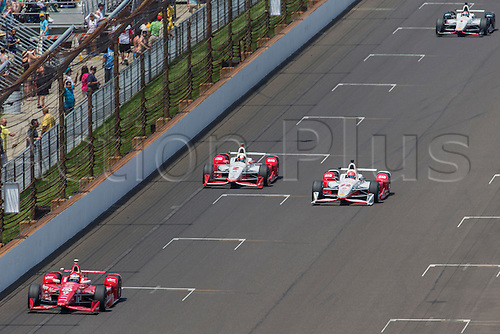 25.05.2015. Indianapolis, IN, USA.   Simon Pagenaud (22) battles with  Juan Pablo Montoya (2) during the running of the 99th Indianapolis 500 in Indianapolis, IN.