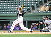 Outfielder Will Muzika (2) of the Furman University Paladins hits in a game against the Northwestern Wildcats on Saturday, February 16, 2013, at Fluor Field in Greenville, South Carolina. The game was cancelled in the fifth inning due to snow. (Tom Priddy/Four Seam Images)