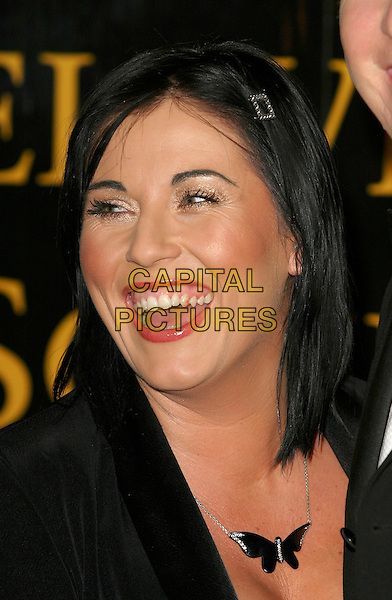 JESSIE WALLACE.RTS Awards, Grosvenor House, London..16th March 2004..portrait headshot butterfly necklace.Ref: BR.www.capitalpictures.com.sales@capitalpictures.com.©Capital Pictures.