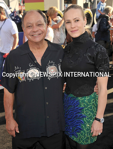 """CHEECH MARIN AND NATASHA RUBIN.attends the World Premiere of Disney Pixar's """"Cars 2"""" at the El Capitan Theatre on June 18, 2011 in Hollywood, California_18/06/201.Mandatory Photo Credit: ©Crosby/Newspix International. .**ALL FEES PAYABLE TO: """"NEWSPIX INTERNATIONAL""""**..PHOTO CREDIT MANDATORY!!: NEWSPIX INTERNATIONAL(Failure to credit will incur a surcharge of 100% of reproduction fees).IMMEDIATE CONFIRMATION OF USAGE REQUIRED:.Newspix International, 31 Chinnery Hill, Bishop's Stortford, ENGLAND CM23 3PS.Tel:+441279 324672  ; Fax: +441279656877.Mobile:  0777568 1153.e-mail: info@newspixinternational.co.uk"""