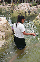 One of Memo´s workers cleans a cenote. Photos for Jasai´s catalogue of the houses of Memo and the surrounding area