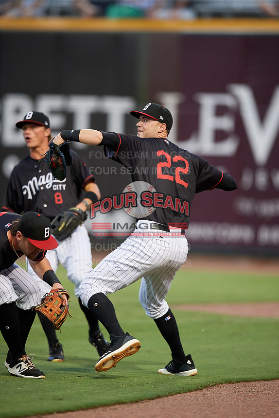 Birmingham Barons first baseman Matt Rose (22) throws back into the infield in front of right fielder Alex Call (8) during a game against the Tennessee Smokies on August 16, 2018 at Regions FIeld in Birmingham, Alabama.  Tennessee defeated Birmingham 11-1.  (Mike Janes/Four Seam Images)
