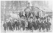 A large crowd of passengers posing for the camera on and around engine #5 with the first train to arrive in Cripple Creek.<br /> Colorado Springs &amp; Cripple Creek District  Cripple Creek, CO  3/27/1901