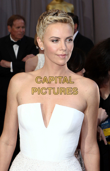 Charlize Theron (wearing Dior Couture).85th Annual Academy Awards held at the Dolby Theatre at Hollywood & Highland Center, Hollywood, California, USA..February 24th, 2013.oscars half length dress white strapless short cropped hair pixie cut .CAP/ADM/SLP/COL.©Colin/StarlitePics/AdMedia/Capital Pictures