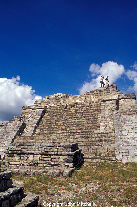 Tourists on top of the Acroplois, the main structure at at the Mayan ruins of Chinkultic near Comitan, Chiapas, Mexico