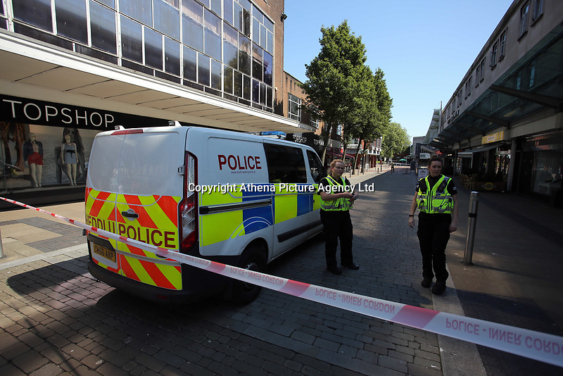 Pictured: Police in Oxford Street in Swansea city centre with the entrance to the Quadrant in the background Wednesday 24 May 2017<br />