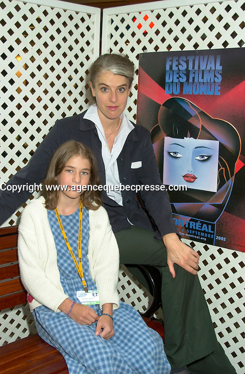 August 29,  2002, Montreal, Quebec, Canada<br /> <br /> EXCLUSIVE PHOTO<br /> Anne Wild, Film Maker (L) and 11year old actress Henriette Confurius, pose before the press conference for  Wild's movie<br /> MEIN ERSTES WUNDER (My First Miracle), presented in the official competitionof the 26th World Film Festival, August 29, 2002<br /> Born in Offenburg, Germany in 1967, Anne Wild studied literature, philosophy and art history at the University of Freiburg and acting at the Academy of Music and Applied Arts in Stuttgart. In the mid-1990s she worked in advertising in Hamburg and Berlin, then studied screenwriting and directing. Since 1997 she has worked as a freelance journalist for newspapers, radio and television. She wrote the script for WAS TUN, WENN'S BRENNT? (2002) and directed Afternoon in Siedlisko (2000) and Ballett ist ausgefallen (2001). MY FIRST MIRACLE marks her directorial debut in features. <br /> , LUCIE AUBRAC (Claude Berri, 1997), THE COMEDIAN HARMONISTS (Joseph Vilsmaier, 1997), and two by Tom Tykwer, WINTERSLEEPERS (1997) and RUN, LOLA, RUN (1998). He starred in Roland Suso Richter's hit film THE TUNNEL (2001), winner of the audience award at last year's Montreal World Film Festival, and his most recent film, THE SEAGULL'S LAUGHTER, is also showing at this year's Festival. He represents the new wave of german actors. <br /> <br /> <br /> Mandatory Credit: Photo by Pierre Roussel- Images Distribution. (&copy;) Copyright 2002 by Pierre Roussel <br /> <br /> NOTE : <br />  Nikon D-1 jpeg opened with Qimage icc profile, saved in Adobe 1998 RGB<br /> .Uncompressed  Uncropped  Original  size  file availble on request.