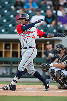 Christian Bethancourt (38) follows through on his swing against the Charlotte Knights at BB&T BallPark on August 11, 2015 in Charlotte, North Carolina.  The Knights defeated the Braves 3-2.  (Brian Westerholt/Four Seam Images)