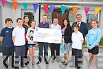 CHEQUE: On Monday at Spa NS pupils of Mrs Mary Griffin-Crowe's Class who presented a cheque of €405 to Ronan Redician (chairperson of kerry branch of Down/Syndrome, l-r: harry Benner, Kevin O'Connor, Mary Griffin-Crowe(teacher), Caitlinn Crowe, Ronan Redican (KBDS), Stephen Dolan, Helen O'Brien (Parent Council), Ronan O'Brien, Peter Linehan (principal) and Caoimhe Ní Loinsgish.