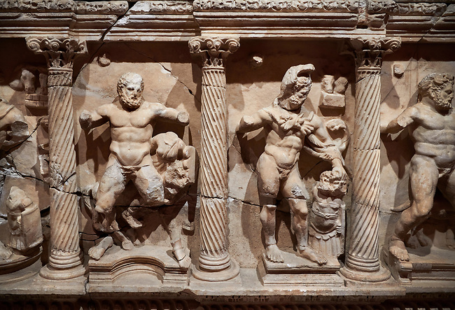 """Roman Herakles (Hercules)  relief sculptured sarcophagus, 2nd century AD, Perge, inv 928. it is from the group of tombs classified as. """"Columned Sarcophagi of Asia Minor"""".  Antalya Archaeology Museum, Turkey"""
