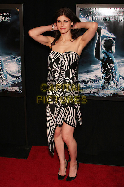 "ALEXANDRA DADDARIO.New York Special Screening of ""Percy Jackson & The Olympians: The Lightning Thief"" held at AMC Loews Lincoln Square, New York, NY, USA..February 4th, 2010.full length black white striped stripes strapless dress hands on head in hair armpits.CAP/LNC/TOM.©LNC/Capital Pictures."