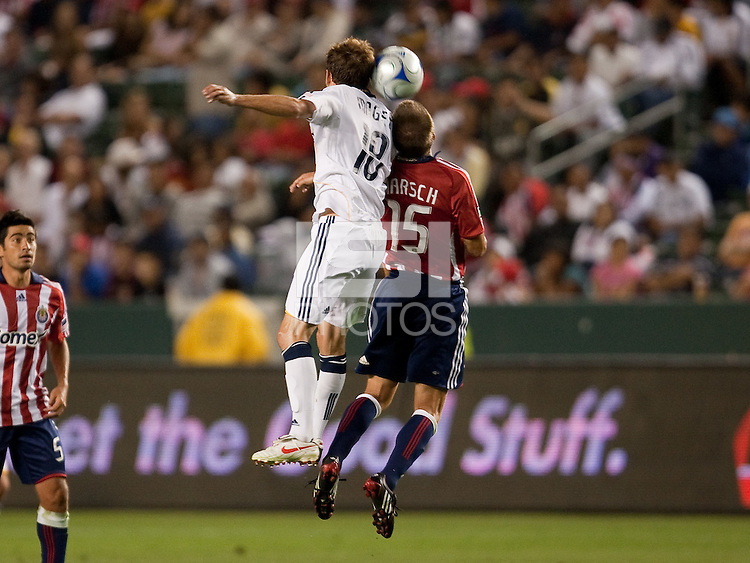 Mike Magge (18) goes up for the header against Jesse Marsch (15). The LA Galaxy defeated Chivas USA 1-0 at Home Depot Center stadium in Carson, California Saturday evening July 11, 2009.