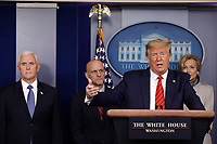 United States President Donald J. Trump speaks during a press briefing on the Coronavirus COVID-19 pandemic with members of the Coronavirus Task Force at the White House in Washington on March 19, 2020. Standing behind the President are: US Vice President Mike Pence, Stephen Hahn, Commissioner, US Food and Drug Administration (FDA) and Dr. Deborah L. Birx, White House Coronavirus Response Coordinator.<br /> Credit: Yuri Gripas / Pool via CNP/AdMedia