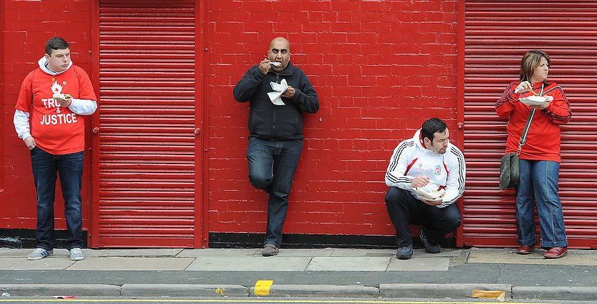 Fans eat take away food outside Anfield, home of Liverpool FC before the match..Football - Barclays Premiership - Liverpool v Manchester United - Sunday 23rd September 2012 - Anfield - Liverpool..