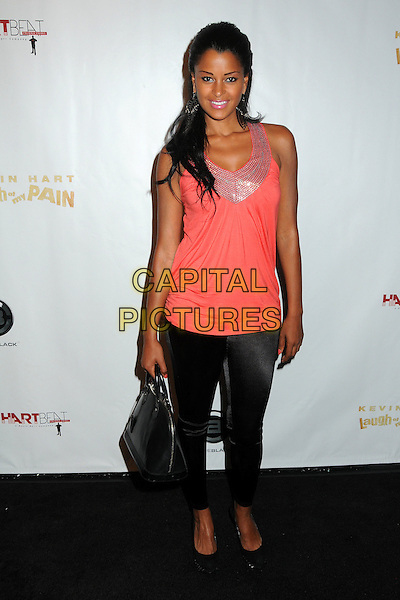 "Claudia Jordan.Kevin Hart's ""Laugh At My Pain"" Los Angeles Premiere held at the Pacific Design Center, West Hollywood, California, USA..September 7th, 2011.full length top leggings black pink beads beaded .CAP/ADM/BP.©Byron Purvis/AdMedia/Capital Pictures."