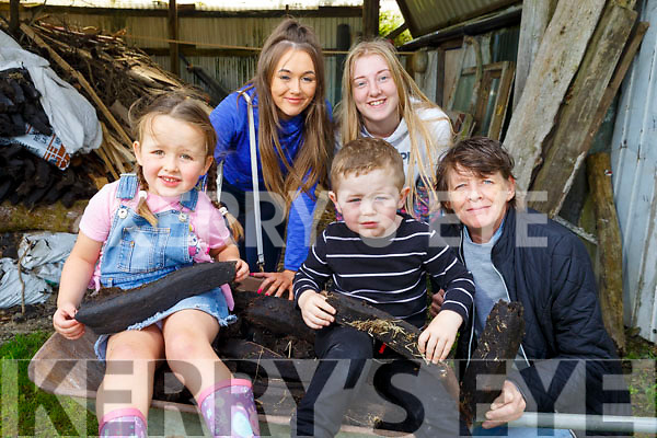 Having a good time in Knocknagoshel on Friday bring in the turf at the family fun day.<br /> Sitting in the wheelbarrow Ella Curtin Joyce and Cian Brosnan O'Mahoney.<br /> Kneeling Helena O'Mahoney<br /> Back l to r: Caz Sommers and Kayleith Duncan.