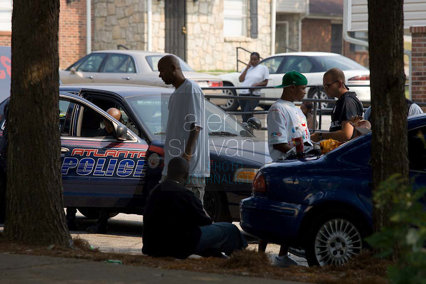 Atlanta Police Department officers detain and question people during sweeps in the Vine City Terrace Apartments on Saturday, August 18, 2007. Police said they found drugs, drug money and at least one stolen car during the sweeps, which also included Bowen Homes.
