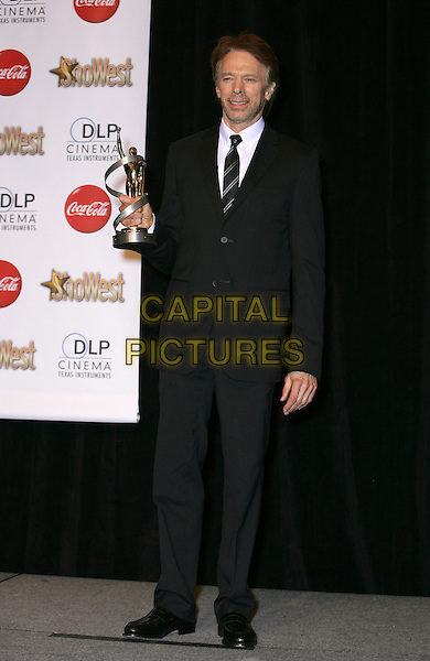 JERRY BRUCKHEIMER .SHOWEST Final Night Talent Awards at the Paris Resort Hotel and Casino,  Las Vegas, Nevada , USA,.18th March 2010..full length  black suit tie award winner trophy .CAP/ADM/MJT.© MJT/AdMedia/Capital Pictures.