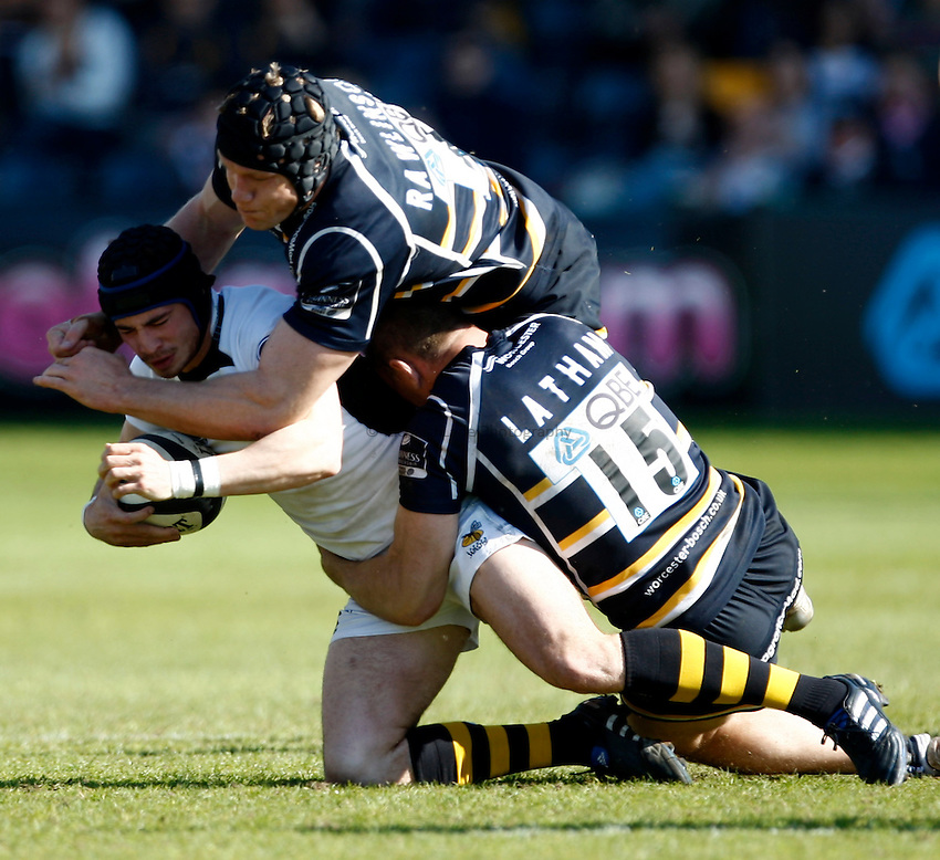 Photo: Richard Lane/Richard Lane Photography. Worcester Warriors v London Wasps. Guinness Premiership. 17/04/2010. Wasps' Danny Cipriani is tackled  by Warriros' Greg Rawlinson and Chris Latham.