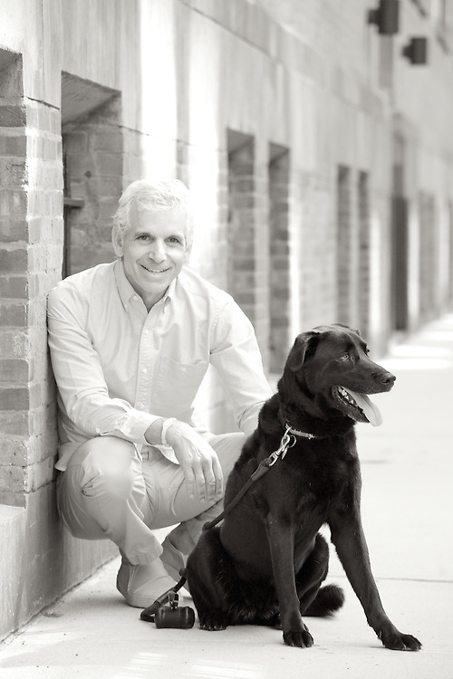 Black & white portrait of man with his dog.