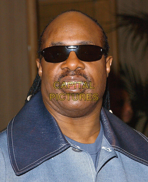 STEVIE WONDER.attends The Time to Give Gala Benefiting the Afghanistan World Foundation held at the St. Regis Hotel in Century City .02/12/03.portrait, headshot, sunglasses, shades, collar.www.capitalpictures.com.sales@capitalpictures.com.©Capital Pictures.