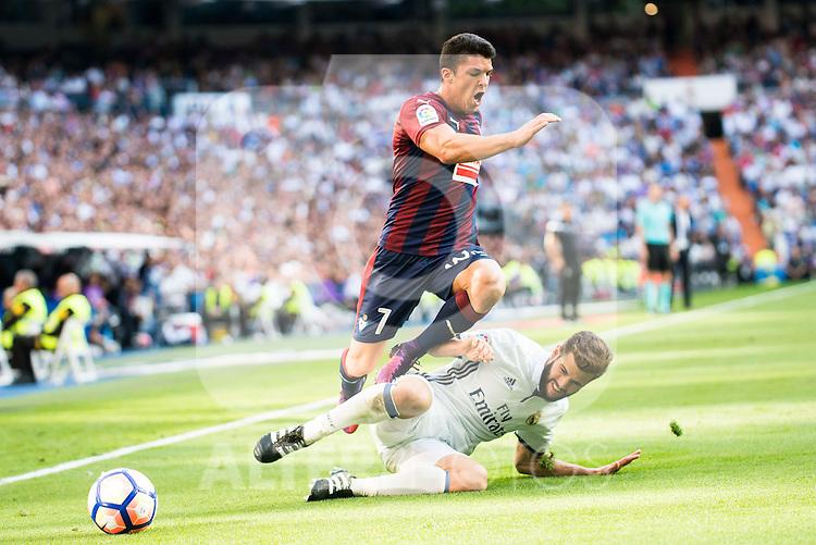 Real Madrid's player Nacho Fernandez and Eibar FC's player Ander Capa during a match of La Liga Santander at Santiago Bernabeu Stadium in Madrid. October 02, Spain. 2016. (ALTERPHOTOS/BorjaB.Hojas)