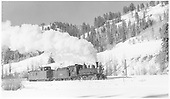 RGS 4-6-0 #20 with caboose #0404 leaving Montelores.<br /> RGS  Montelores, CO  Taken by Richardson, Robert W. - 11/16/1951