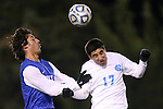 06 November 2012: Duke's Jonathan Aguirre (left) and UNC's Danny Garcia (right) challenge for a header. The University of North Carolina Tar Heels defeated the Duke University Blue Devils 1-0 at Fetzer Field in Chapel Hill, North Carolina in a 2012 NCAA Division I Men's Soccer game. The game was an Atlantic Coast Conference quarterfinal match.