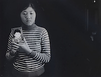 """Mrs Tang, 26, holds a picture of her only son, Chen Zhijie, 5 years and 3 months, who was stolen, she believes by a neighborhood gang. Message read """"My poor son where are you? I miss you very much. Are you okay now? Please come back. Mum can't live without you. Mum dreams of you every night, dreaming that have come back to our sides. Don't know when can our dream comes true.""""..PHOTO BY SINOPIX"""