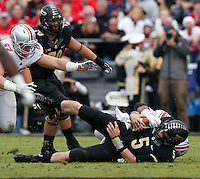 Purdue Boilermakers quarterback Danny Etling (5) is sacked by Ohio State Buckeyes defensive lineman Michael Bennett (63) during Saturday's NCAA Division I football game at Ross-Ade Stadium in West Lafayette, In. on November 2, 2013. (Barbara J. Perenic/The Columbus Dispatch)