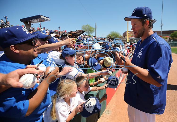 Los Angeles Dodgers fans get autographs from Clayton Kershaw before a spring training game in Glendale, Ariz., on Friday, March 24, 2017.<br /> Photo by Cathleen Allison/Nevada Photo Source