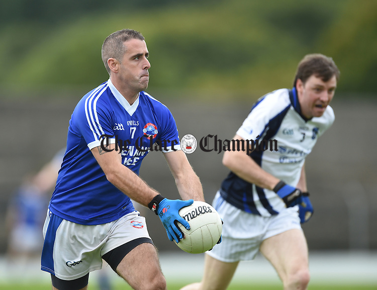 Micheal Keane of Kilkee in action against Barry Duggan of Cratloe during their game in Lissycasey. Photograph by John Kelly.