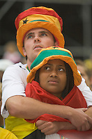Germany, DEU, Dortmund, 2006-Jun-27: FIFA football world cup (USA: soccer world cup) 2006 in Germany; two Ghanaian football fans viewing the world cup match Brazil vs. Ghana (3:0) with sad faces due to the defeat of the Ghanaian team.