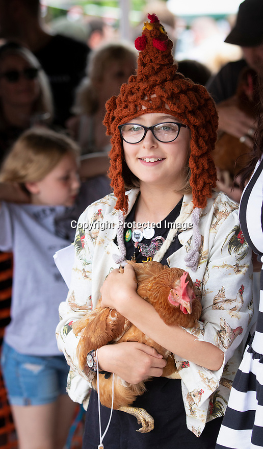 04/08/19<br /> <br /> Hen costume.<br /> <br /> Hundreds of spectators watch as competitors race their hens at the World Championship Hen Racing on a purpose-built track outside the Barley Mow pub in Bonsall, in the Derbyshire Peak District.<br />  <br /> All Rights Reserved, F Stop Press Ltd +44 (0)7765 242650 www.fstoppress.com rod@fstoppress.com