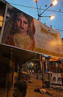 Banners displaying gold are on the street where artisanal goldsmiths work in Kolkata (Calcutta).