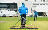 Picture by Allan McKenzie/SWpix.com - 13/04/2018 - Cricket - Specsavers County Championship - Yorkshire County Cricket Club v Essex County Cricket Club - Emerald Headingley Stadium, Leeds, England - Ground staff at Headingley taking water off the surface of the square prior to the first match of the Specsavers County Championship.