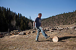 Jeff prepares wood to dry for the winter. The Harris family lives in Northern New Mexico and continues to try living a simple life with few modern commodities.