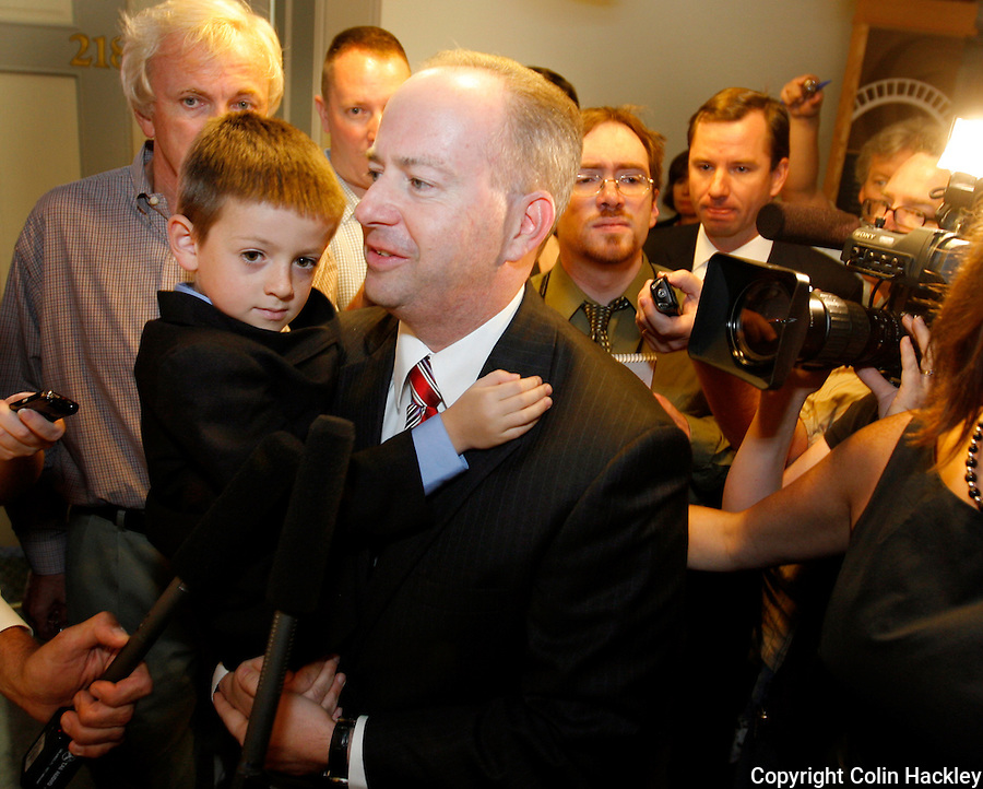 TALLAHASSEE, FL. 8/28/09-LEMIEUX CH09-George LeMieux carries his son Max from the news conference where Gov. Charlie Crist named him to fill the U.S. Senate seat vacated by Mel Martinez, Friday at the Capitol in Tallahassee. LeMieux replaces Martinez who resigned the post and will serve a little more than a year in the role. Crist is running for the U.S Senate seat and hopes to win it in the November 2010 election...COLIN HACKLEY PHOTO