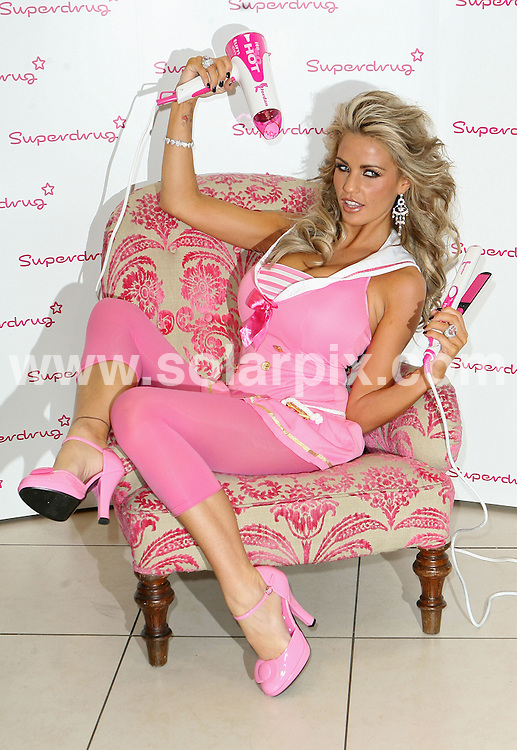 **ALL ROUND PICTURES FROM SOLARPIX.COM**.**WORLDWIDE SYNDICATION RIGHTS**.Katie Price (aka Jordan) promotes the launch of her new range of Hair products at Superdrug, Kensington High Street, London...JOB REF: 5176 SSD     DATE: 05_10_2007.**MUST CREDIT SOLARPIX.COM OR DOUBLE FEE WILL BE CHARGED* *UNDER NO CIRCUMSTANCES IS THIS IMAGE TO BE REPRODUCED FOR ANY ONLINE EDITION WITHOUT PRIOR PERMISSION*