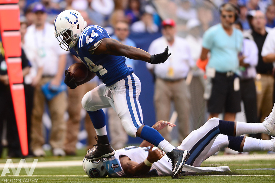 Sep 28, 2014; Indianapolis, IN, USA; Indianapolis Colts running back Ahmad Bradshaw (44) runs the ball during the third quarter against the Tennessee Titans at Lucas Oil Stadium. Colts defeated the Titans 41-17. Mandatory Credit: Andrew Weber-USA TODAY Sports
