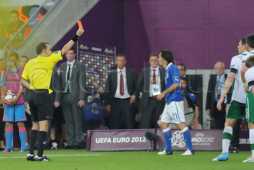 18.06.2012 , Poznan, Poland. Keith Andrews (West Bromwich Albion FC)  Rep of Ireland is shown a yellow and then a red card during the European Championship Group C game between Italy and Ireland from the Municipal Stadium...