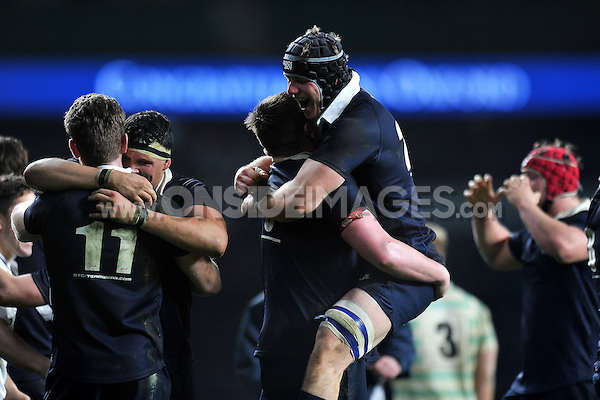 Will Thomas of Oxford University celebrates with team-mates at the final whistle. The Varsity Match between Oxford University and Cambridge University on December 10, 2015 at Twickenham Stadium in London, England. Photo by: Patrick Khachfe / Onside Images