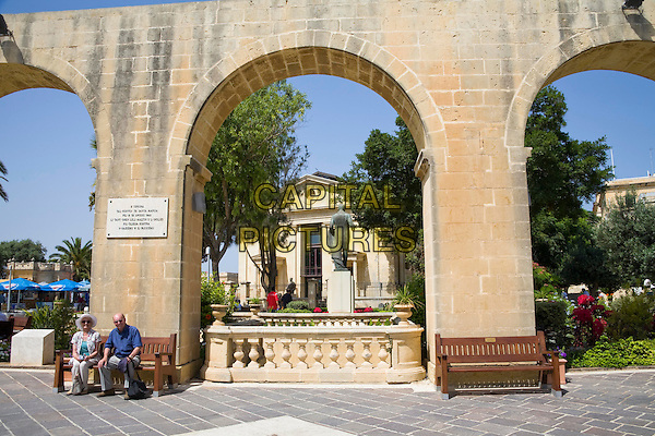 Malta Stock Exchange, Borza Ta Malta, through arches, Upper Barracca Gardens, Valletta, Malta